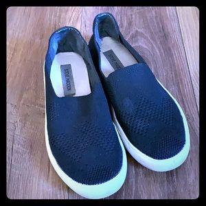 Black slip on shoes by Steve Madden